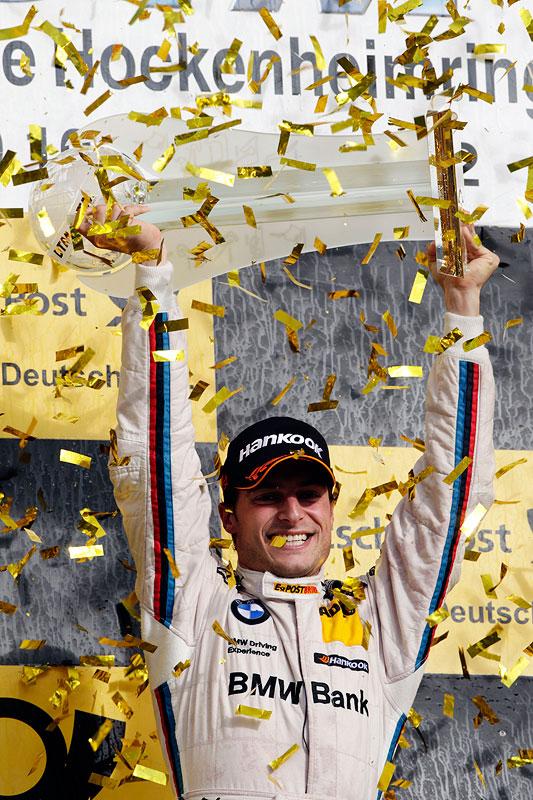 DTM Champion 2012: BMW Fahrer Bruno Spengler auf dem Siegerpodest in Hockenheim