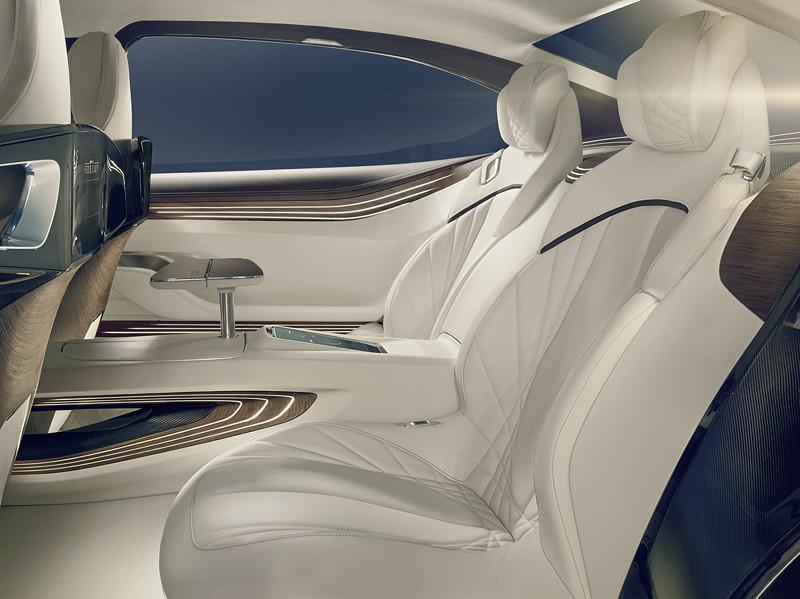 BMW Vision Future Luxury. Interieur. Zwei große Einzelsitze mit tiefer Sitzschale laden ein, sich in den eigenen 'Personal Space' zurückzuziehen.