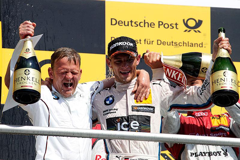 Stefan Reinhold, Teamchef BMW Team RMG und Gewinner Marco Wittmann auf dem Siegerpodest am Hockenheimring