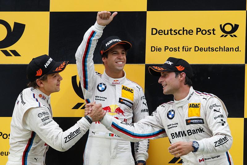 Zandvoort (NL) 12. Juli 2015. BMW Motorsport, Rennen 8, Zweitplatzierter Augusto Farfus (BR), Gewinner Antonio Felix da Costa (PT) und Drittplatzierter Bruno Spengler (CA).