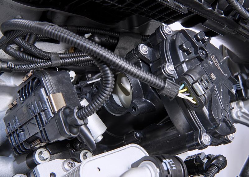 Weiterentwickelter BMW TwinPower Turbo 4-Zylinder Benzinmotor.