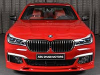 BMW M760Li xDrive M Performance (G12) in Imola Rot mit Tuningteilen von 3D Design in Abu Dhabi