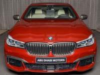 BMW M760Li in Individual rubin rot